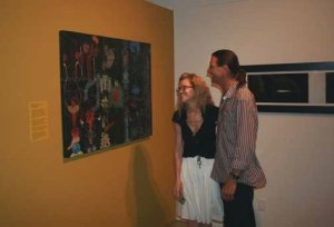 "guests looking at my painting ""Vital Commotion"""